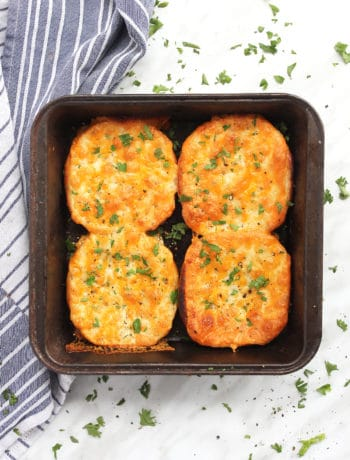 Overhead shot of cheesy garlic bread in a baking tin