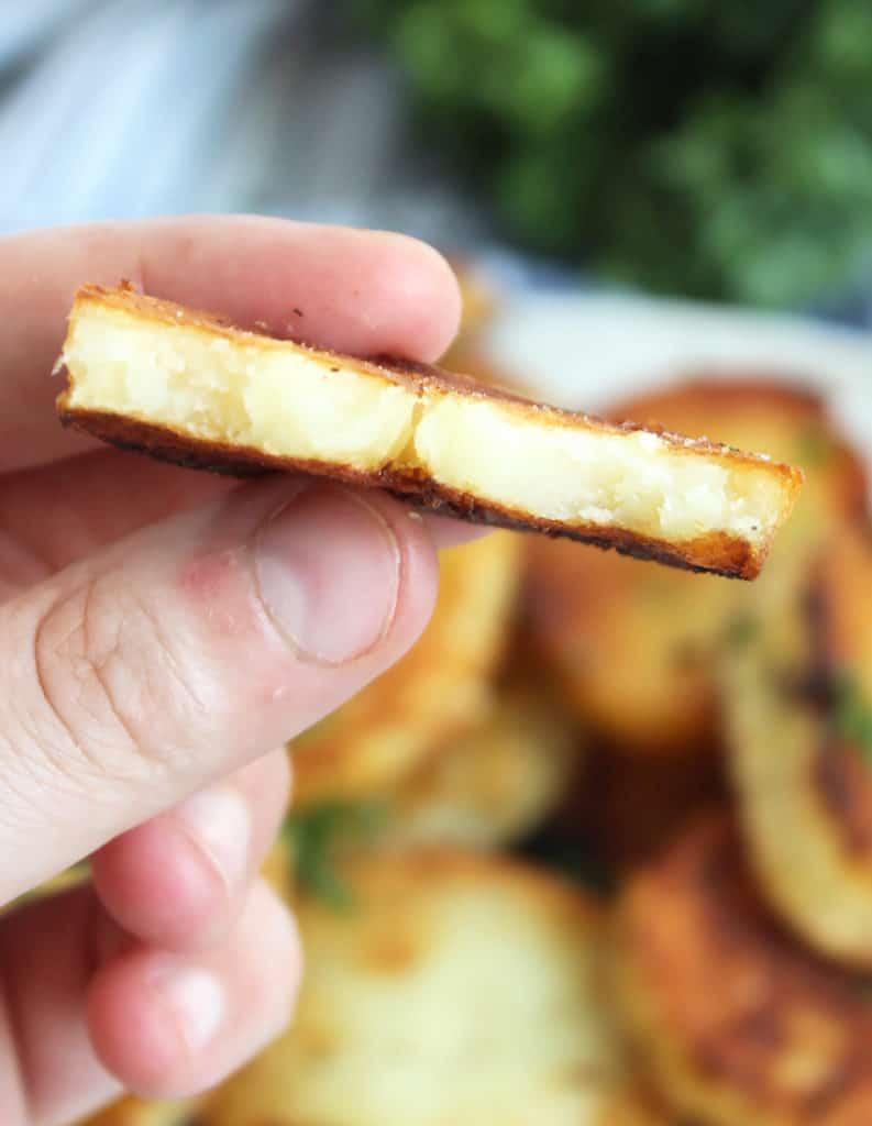 A bite taken out of a potato slice