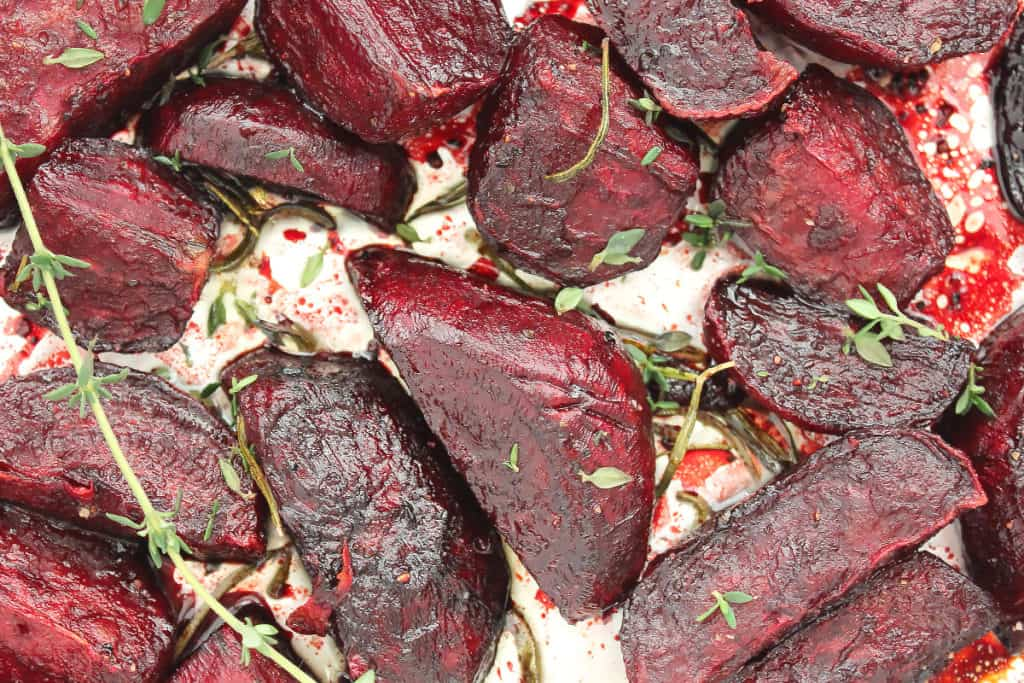 Close up of the roasted balsamic beet wedges on foil.