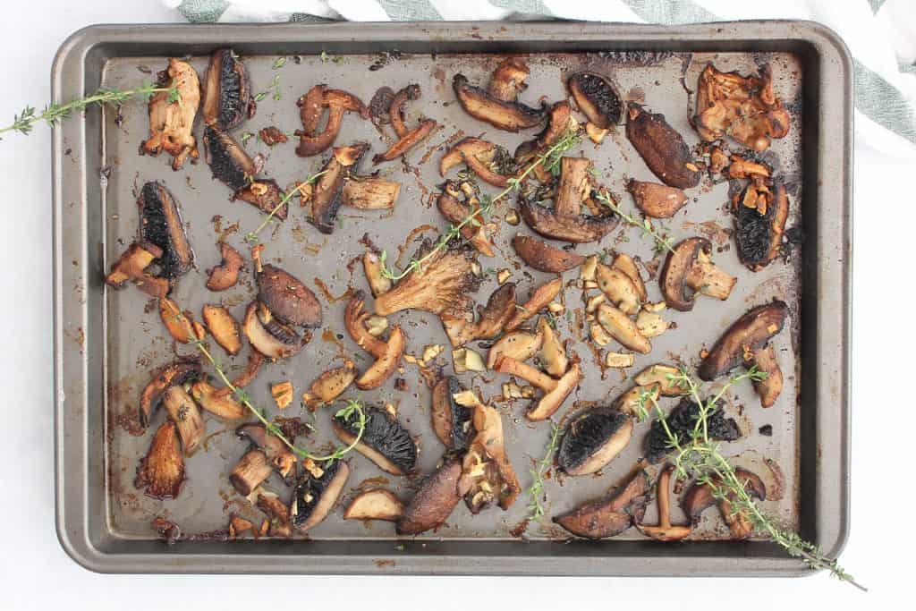 The roasted mushrooms on a sheet pan.