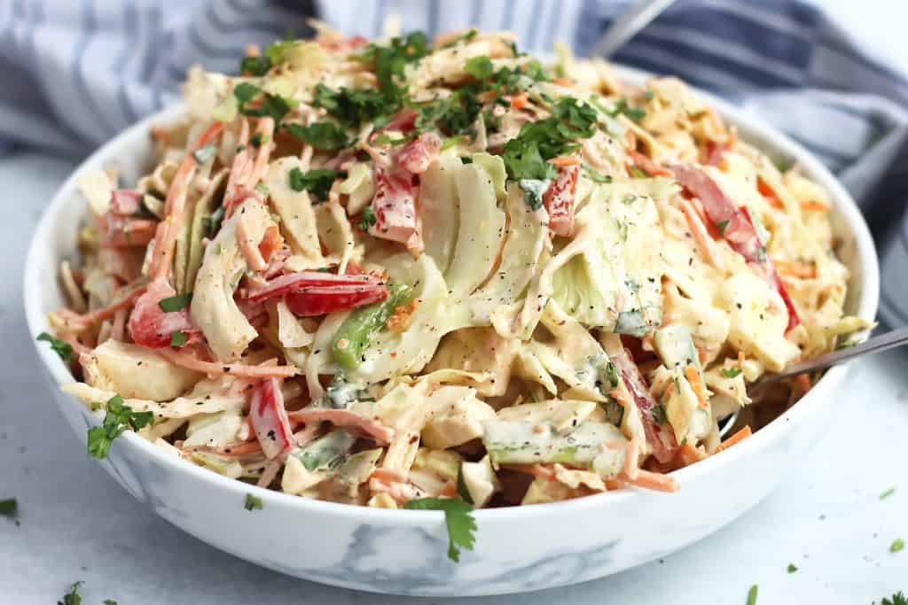 Side view of cajun slaw in a large serving bowl.