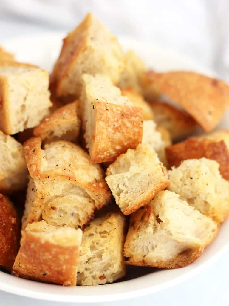 Close up of baked croutons in a bowl.
