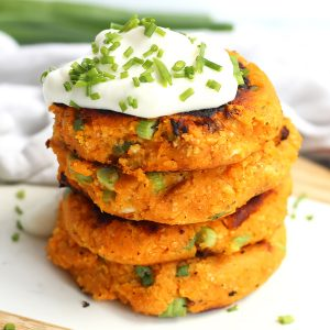 Four sweet potato cakes stacked on top of each other.