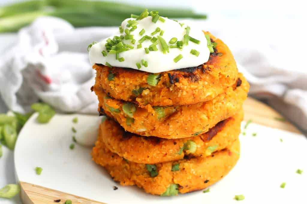 Sweet potato cakes topped with sour cream and chives.