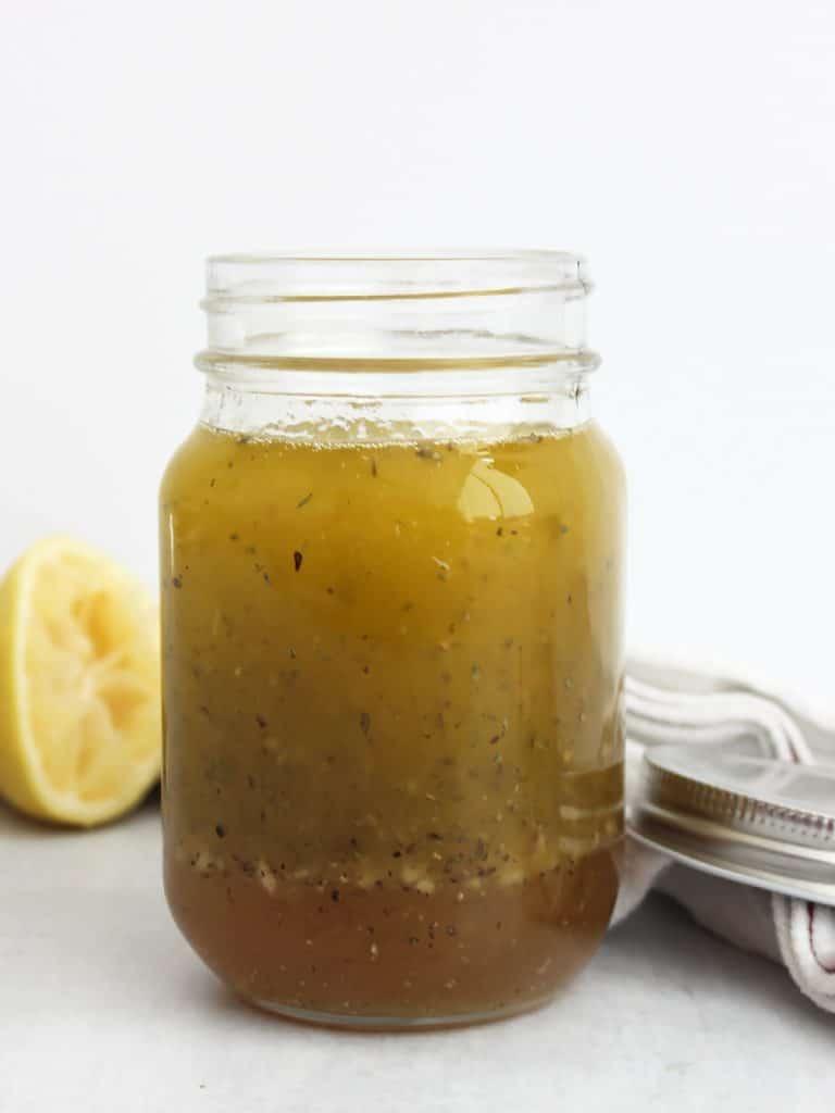 The honey lemon dressing in a mason jar.