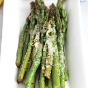 Close up of the melted parmesan on the sauteed asparagus.