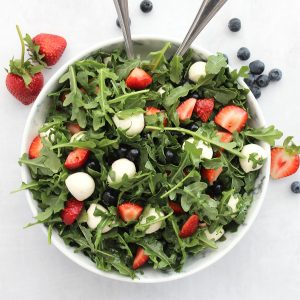 Overhead shot of a red, white and blue salad in a large serving bowl.