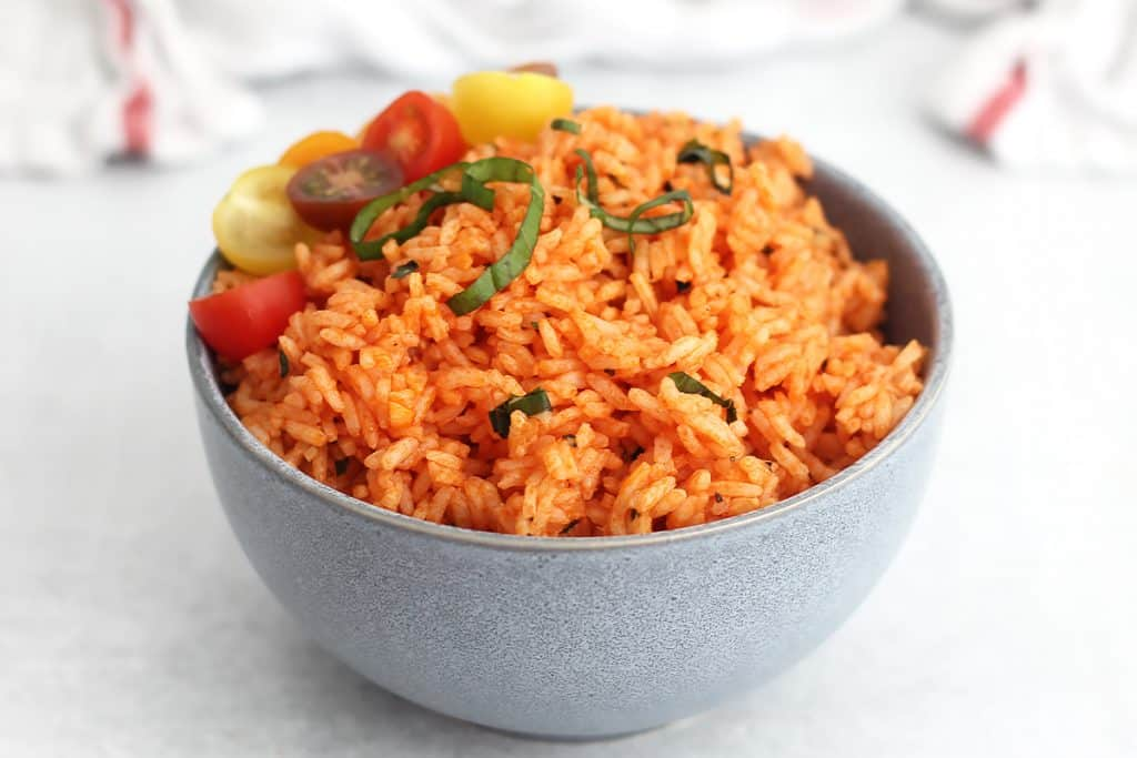 Tomato basil rice in a blue bowl.