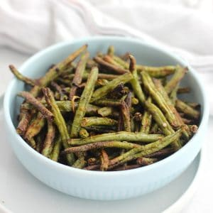 Air fried green beans served in a small blue bowl.