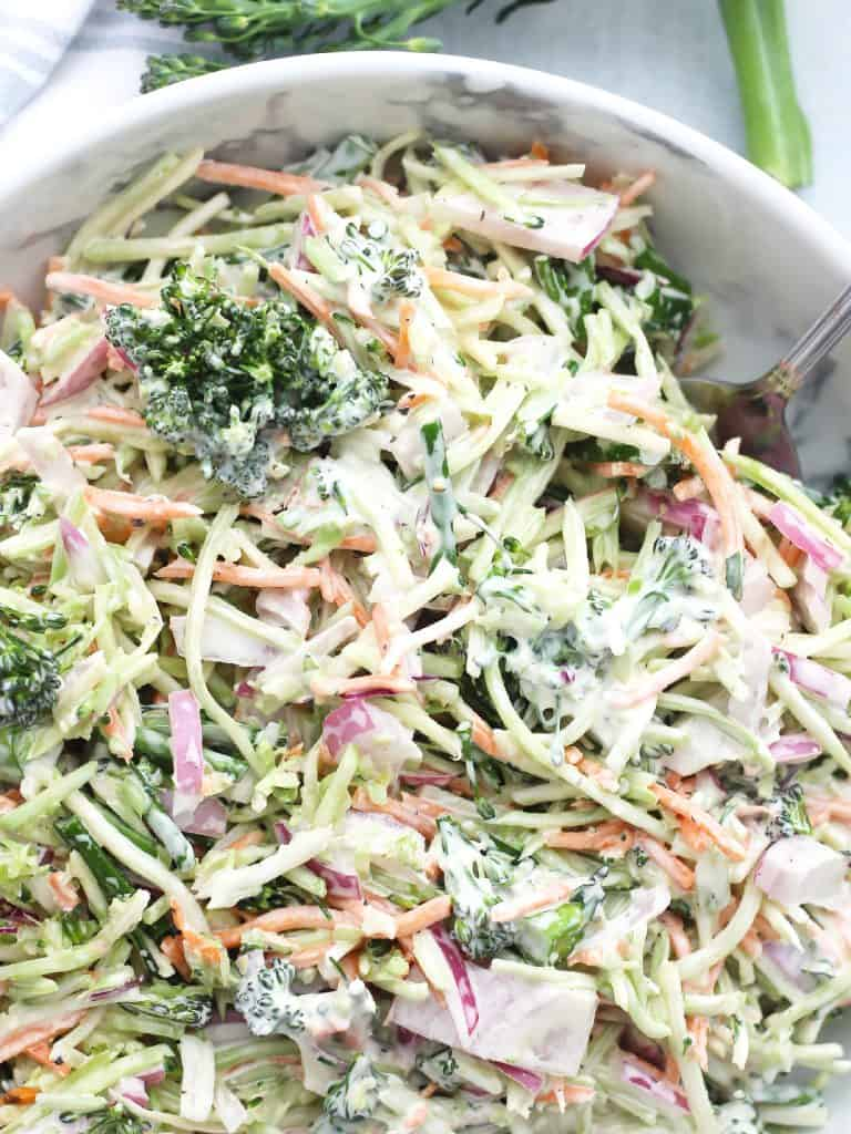 Broccolini slaw in a bowl with a serving spoon.