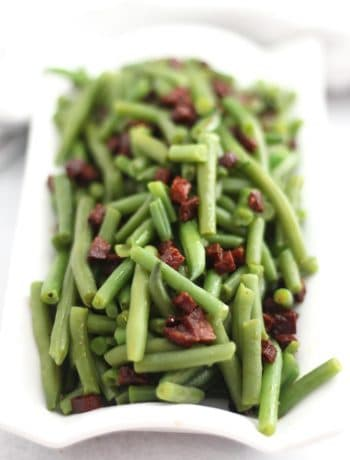 Green beans served with cooked diced chorizo.