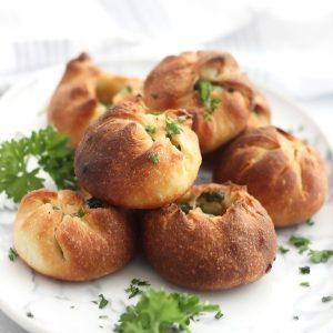 Pizza dough garlic balls garnished with fresh parsley.