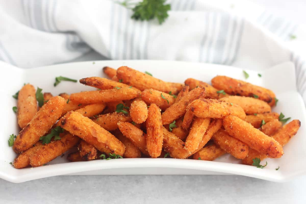 Air fried carrots served on a white plate.