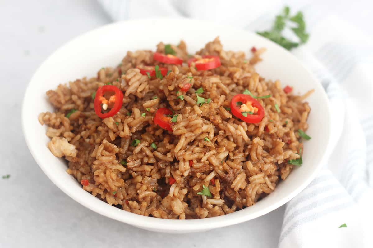 Garlic chili fried rice served in a white bowl.